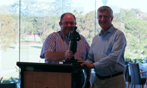 Stuart Cox (left) receiving the Annual Match Trophy from Graeme Bailey (RSGC)